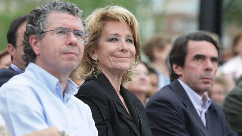 Francisco Granados, Esperanza Aguirre y José María Aznar, en un mitin en mayo de 2011 (de izquierda a derecha).