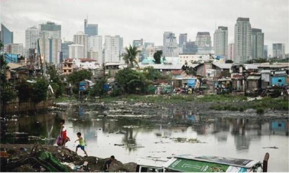 Barrio de chabolas en Tondo, Manila, Filipinas. 2014. Oxfam.org. Foto: Dewald Brand /Miran.
