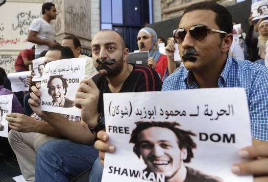 Periodistas egipcios se manifiestan en julio de 2014 para exigir la libertad de Mahmoud Abu Zied, 'Shawkan'. AP. Foto: Amr Nabil.